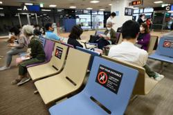 Japan eases entry restrictions for medium, long-term staying foreigners