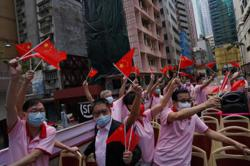Hong Kong raises flags, holds reception to celebrate National Day