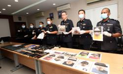 Ipoh cops bust online gambling syndicate, eight arrested