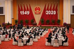 China holds National Day reception, hailing achievements in battling Covid-19 and poverty