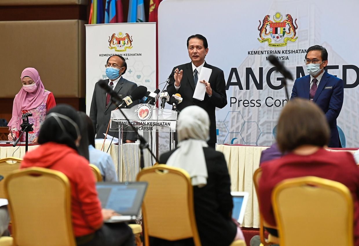 Updating statistics: Dr Noor Hisham speaking during a press conference on Covid-19 at the Health Ministry in Putrajaya. — Bernama