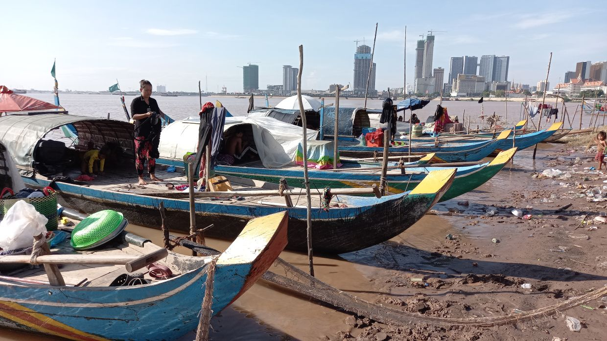 Fishing boats moored to Chroy Changvar, the riparian peninsula where the Mekong and Tonle Sap rivers converge in Phnom Penh.