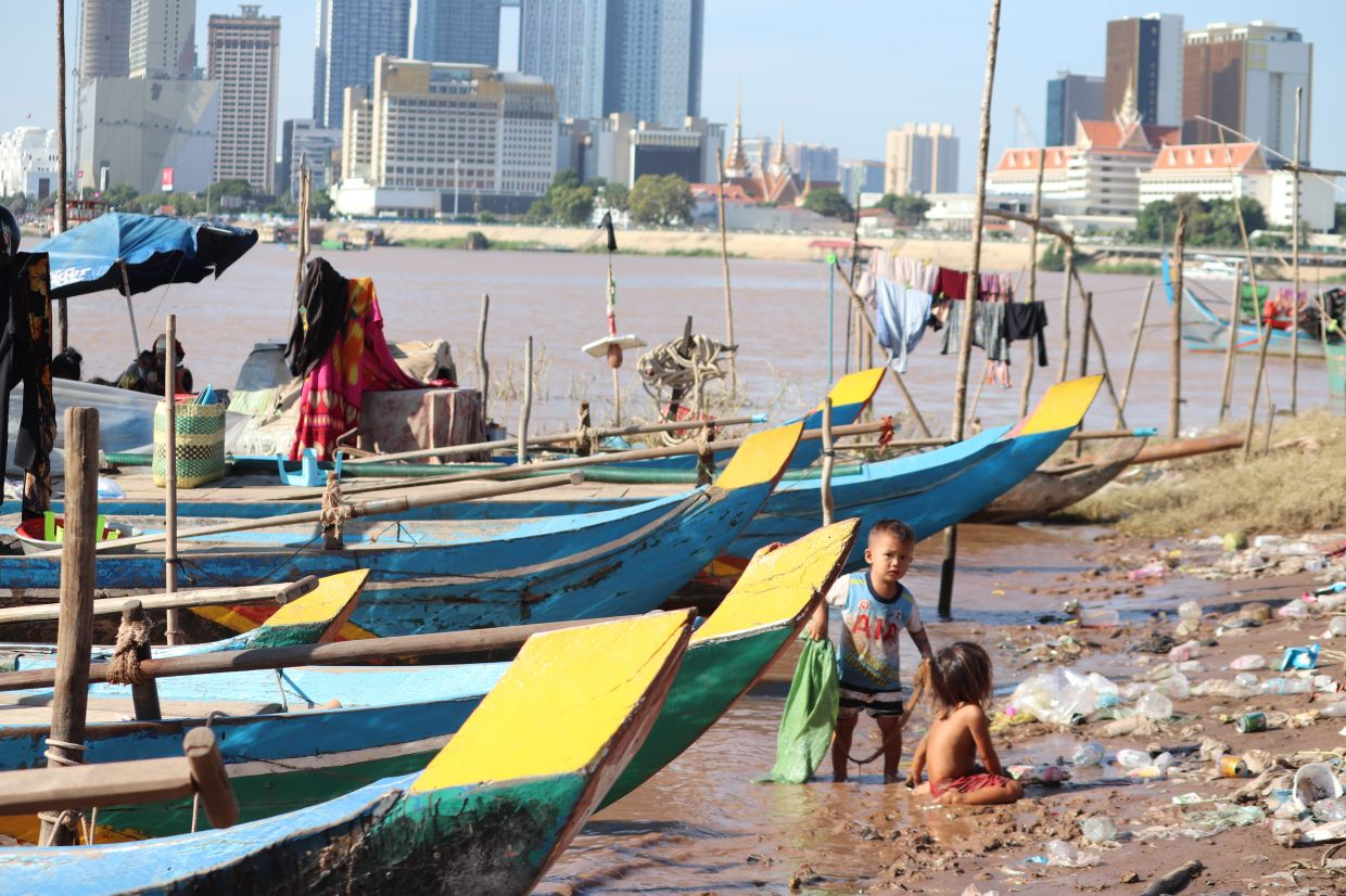 Children of the fishing community play amidst the boats.