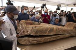 Egypt unveils 59 well-preserved coffins buried 2,500 years ago