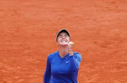 Svitolina breezes past Garcia into last eight at Roland Garros
