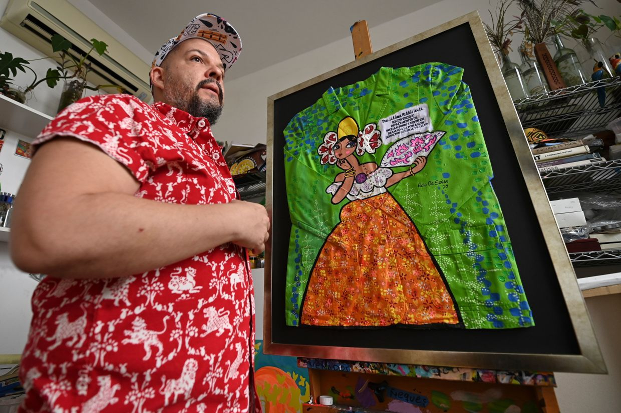 Artist Rolo De Sedas transformed his assigned lab coat, painting it green with a female figure inspired by Panamanian folklore. Photo: AFP