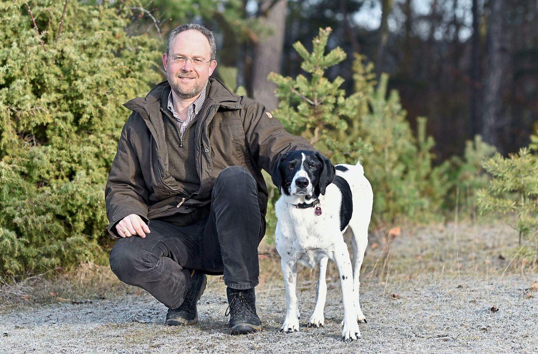 Animal pathologist Achim Gruber and his dog, Benni.