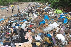 'Clean up illegal dumpsite'