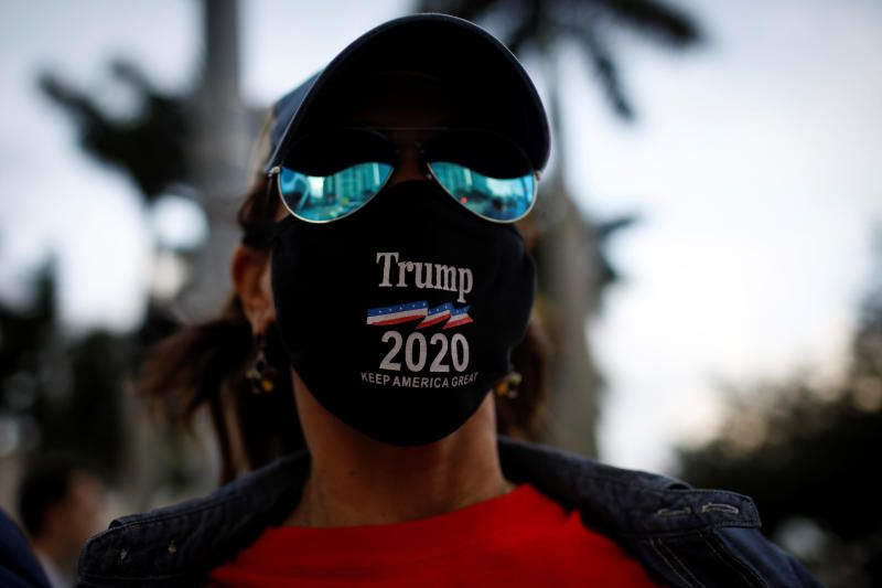 A supporter of US President Donald Trump wearing a protective mask attends a gathering outside Perez Art Museum, before the arrival of Democratic US presidential nominee Joe Biden for a town hall event in Miami. - Reuters