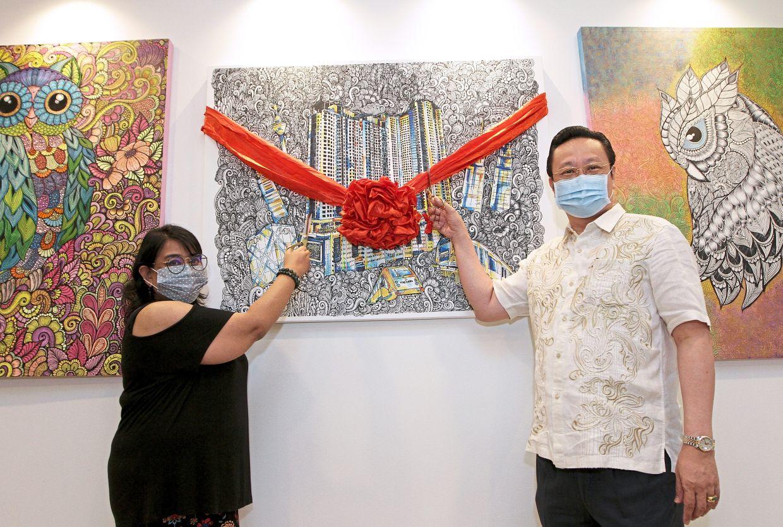 Sarah (left) and Eng  launching LaVile du Chocolat cafe at Aeon Taman Maluri Shopping Centre.