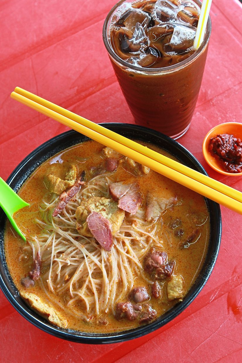 A flavourful bowl of curry mee at Chan Kee Noodle is filled with  lean char siew, spongy tau fu pok, cockles and bean sprouts.