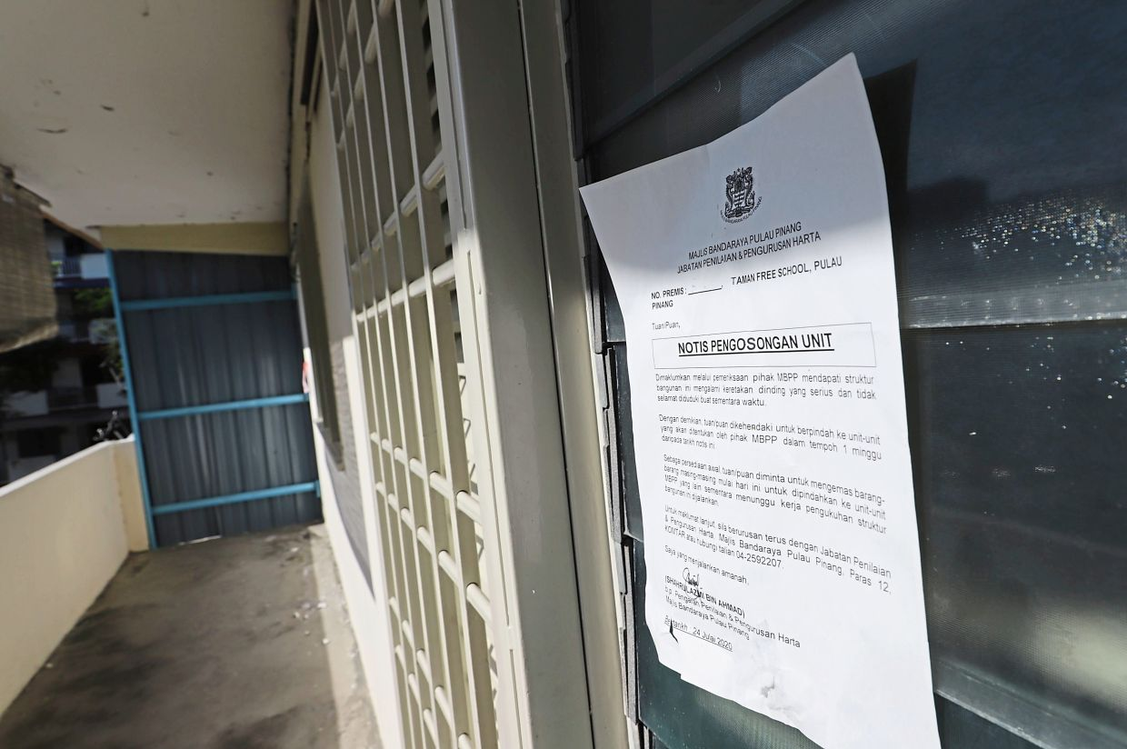 A cordoned-off corridor at the aged Taman Free School walk-up block due to a large crack from top to bottom.