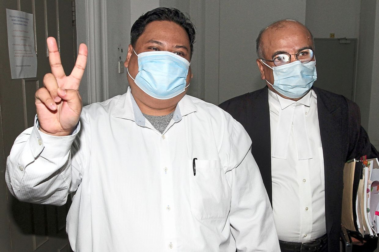 Victory sign: Ibrahim Haikal walks away a free man after the High Court found him not guilty of CBT.