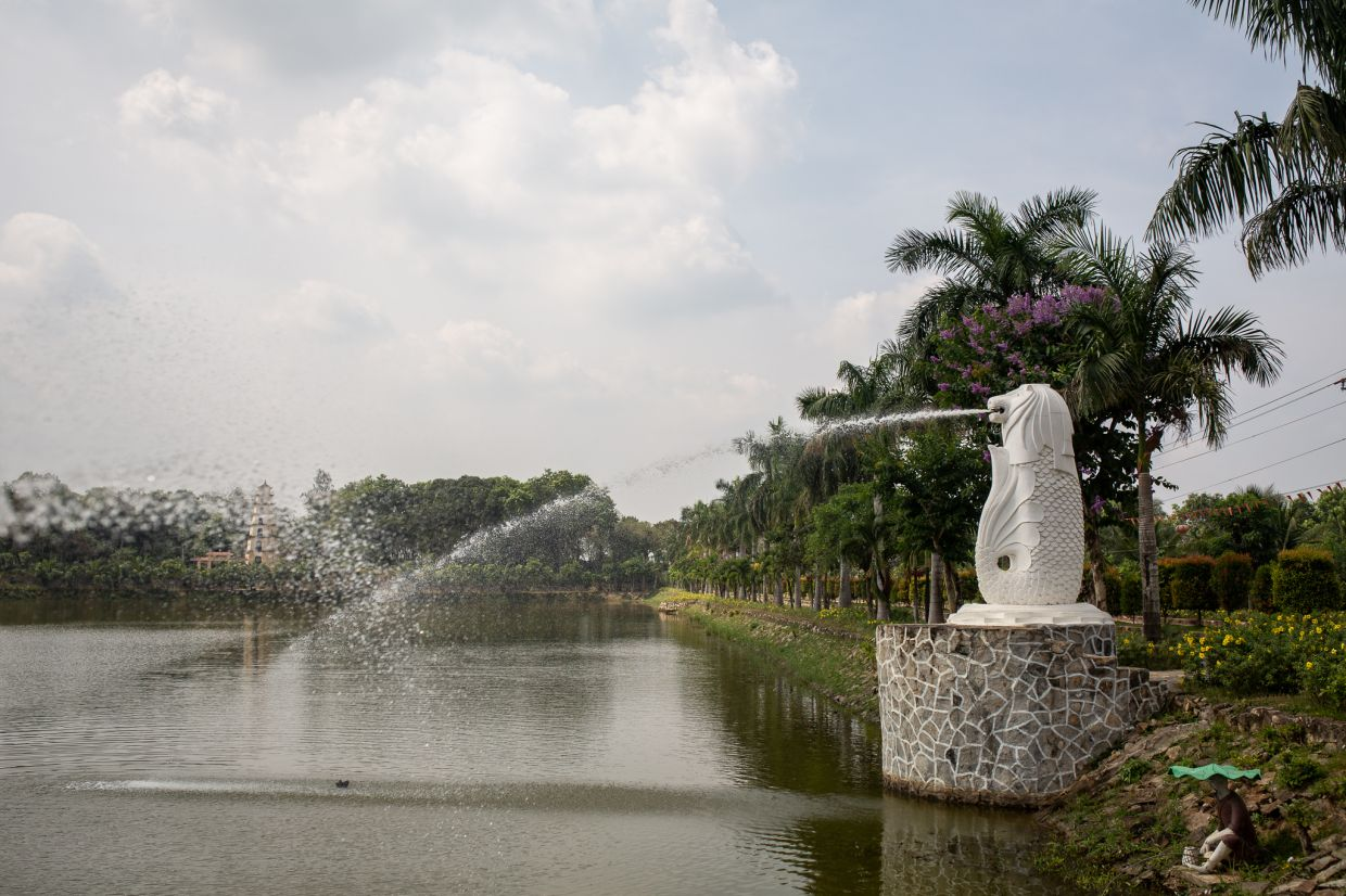 A replica of Singapore's famous Merlion spouts water into one of many lakes that appear across the prison's expansive grounds.