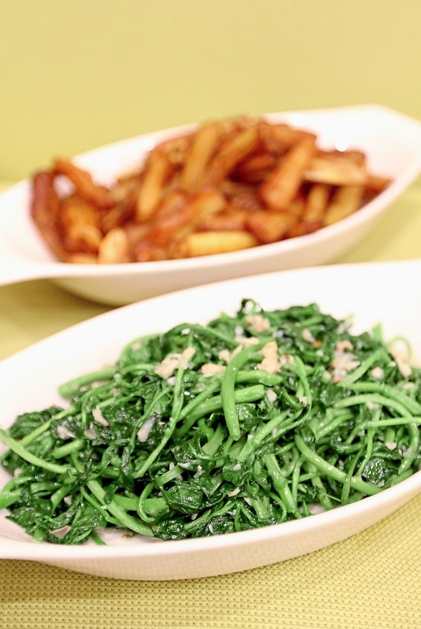 Humans are often infected with the liver fluke after eating raw watercress, seen here in a (safe to eat) stir-fried dish (front) — Filepic