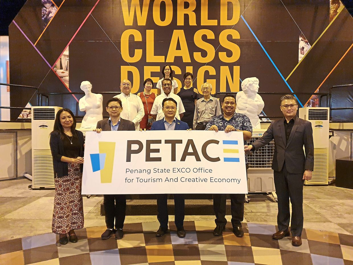 Yeoh (in blue blazer) with representatives from the tourism and creative economy sectors at the launching of the Petac logo at The One Academy in Anson Road, Penang.