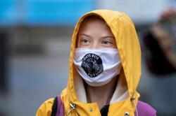 Climate activist Greta Thunberg shows support for Biden in rare political tweet