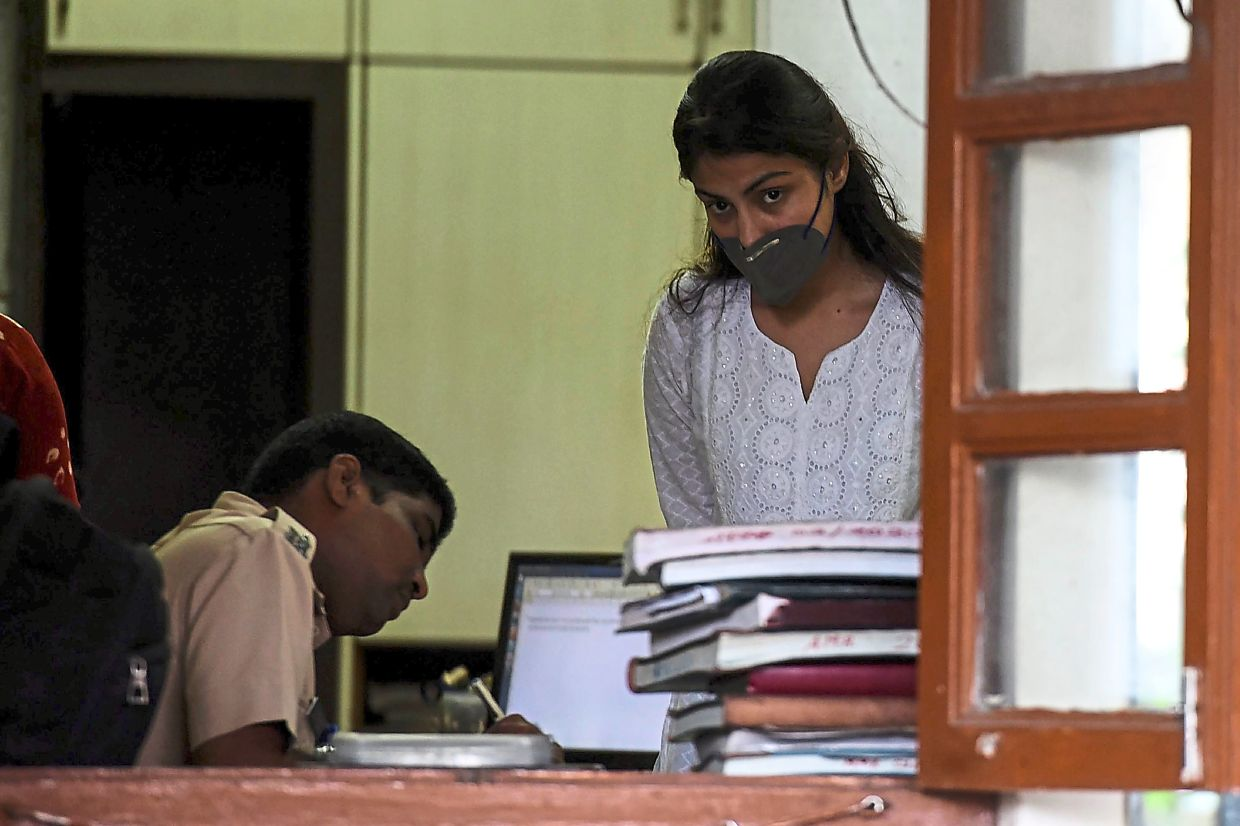 Chakraborty arriving at a police station for an enquiry a day after been granted bail in Mumbai.— AFP