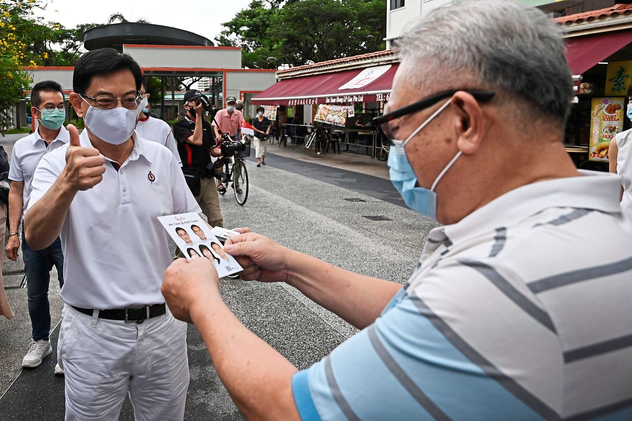 In Singapore, there was limited campaigning on the ground. Here, Singapore's Deputy Prime Minister Heng Swee Keat of the incumbent People's Action Party, went on a walkabout in the Bedok South estate neighbourhood. — AFP
