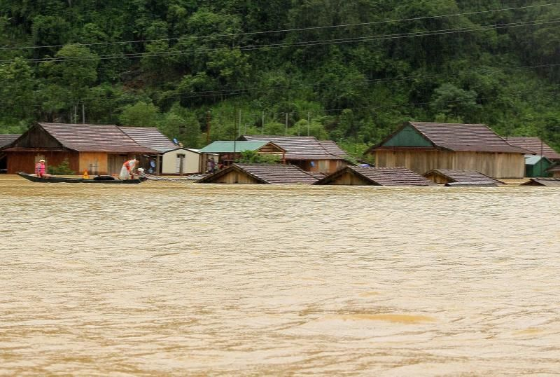 Houses inundated by floodwaters following heavy rainfall in Central Vietnam's Quang Binh province. - AFP
