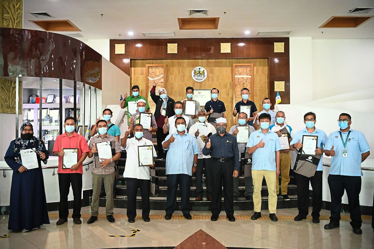 Rozali (in grey) with winners of the MBSP Cleanest Residential Parks and Villages Competition at the MBSP headquarters in Bukit Mertajam, Penang.
