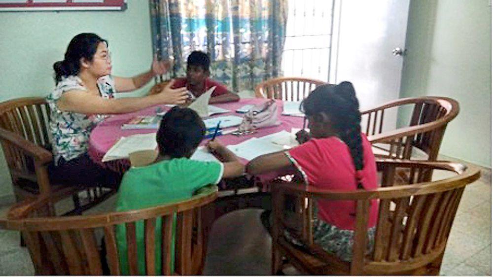 A volunteer tutor teaching the children (before the MCO). Photo: Rumah Perlindungan Sosial YWCA