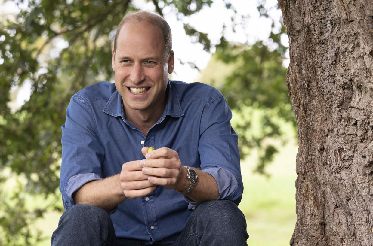 Prince William sits under the canopy of an oak tree during a recording to promote the first TED conference, in the grounds of Windsor Castle. The future king has said there is