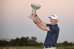 Laird ends drought with playoff win in Las Vegas