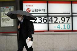 Asian shares mostly higher after US rally, aid package hopes