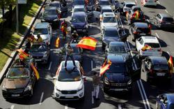 Waving Spanish flags, Vox supporters protest against Madrid lockdown