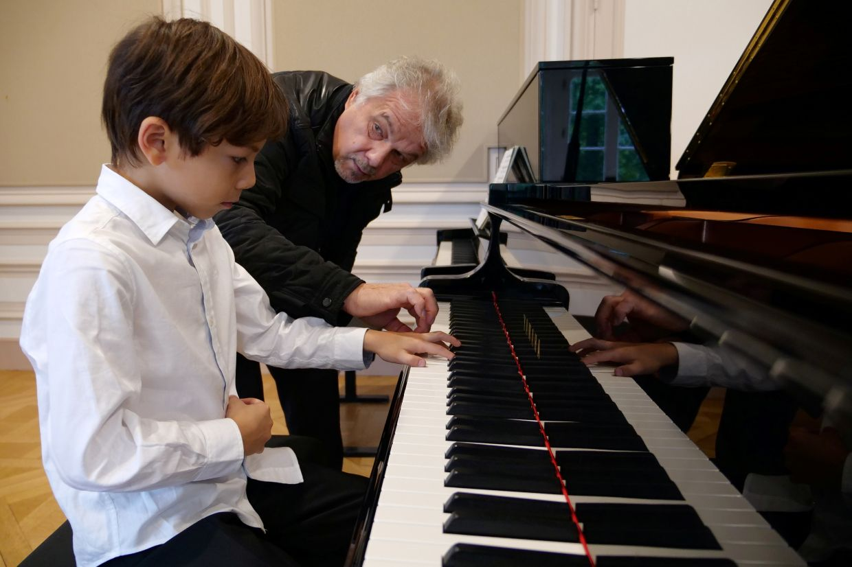 Benoliel practices the piano with his teacher Kouznetsov during a lesson at the conservatory in Yerres, France. Photo: Reuters