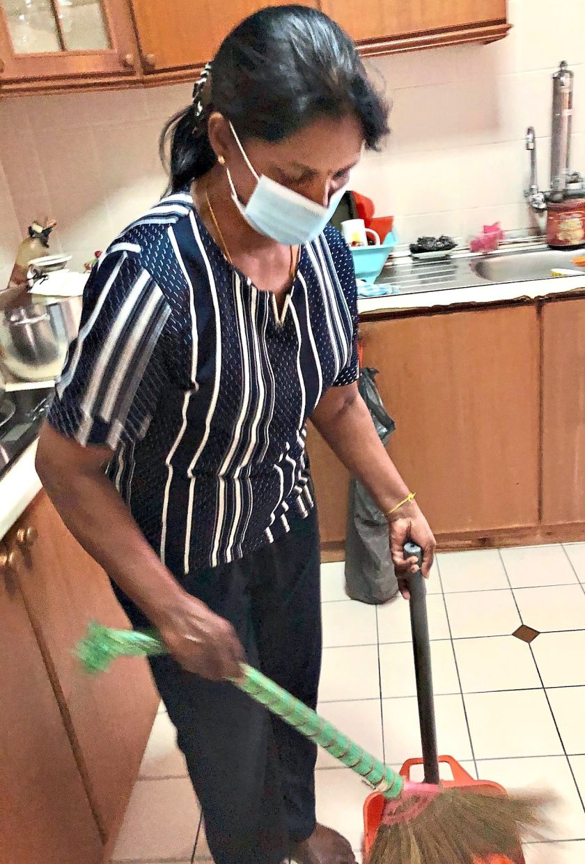 Mathavi, who cleans each home once or twice a week, isn't quite sure what to expect with the conditional MCO. Photo: The Star/Ming Teoh