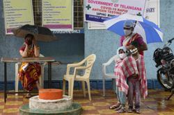 India sees its fewest new cases since mid-August but primary schools in Madya Pradesh are shut