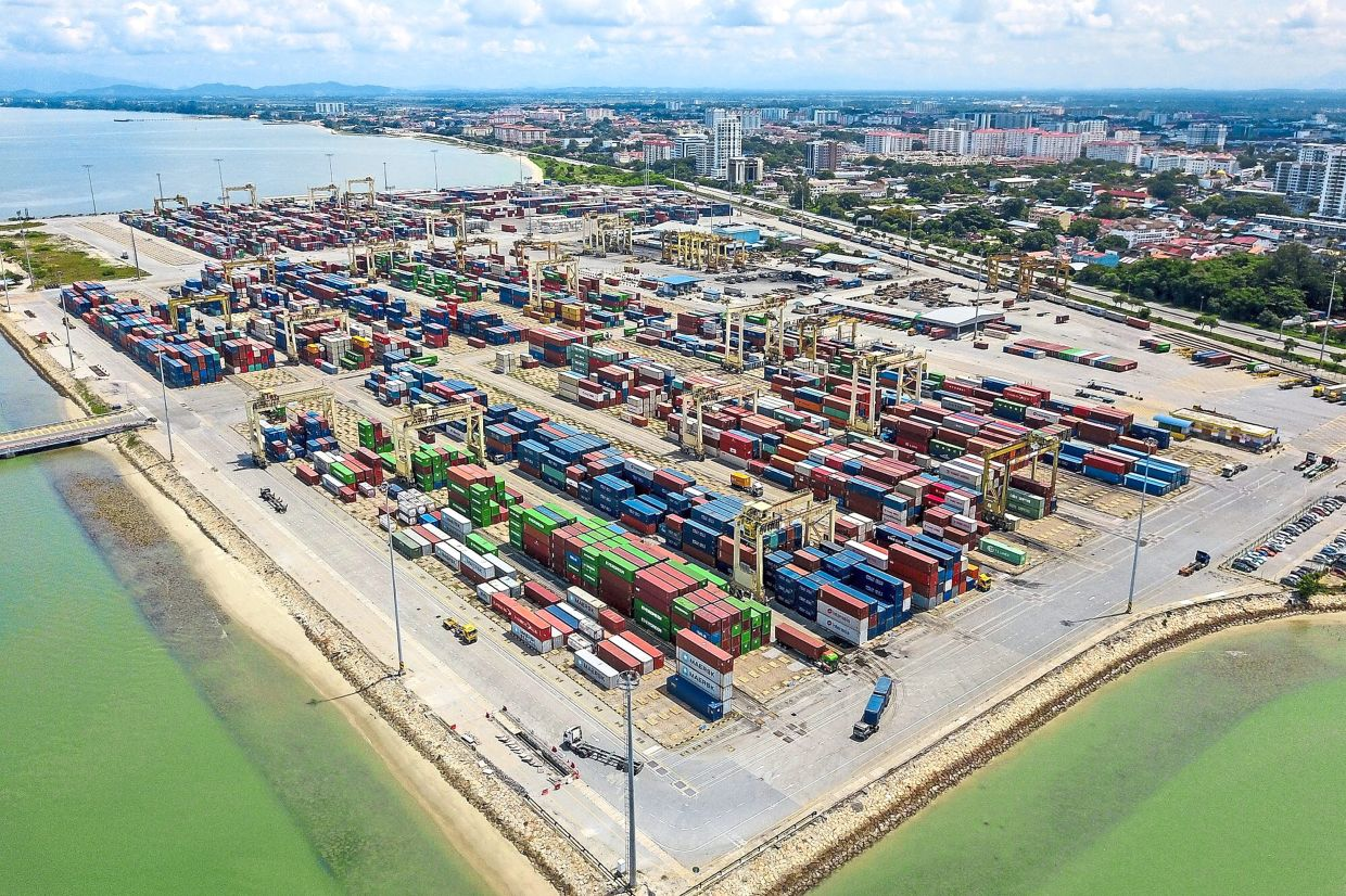 Limiting impact: An aerial view of North Butterworth Container Terminal in Butterworth. The introduction of CMCO, instead of a more restrictive targeted enhanced movement control order, has limited the impact to Malaysia's GDP overall.