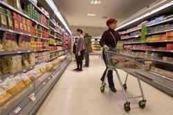 UK consumers, sensing new Covid restrictions, speed up spending