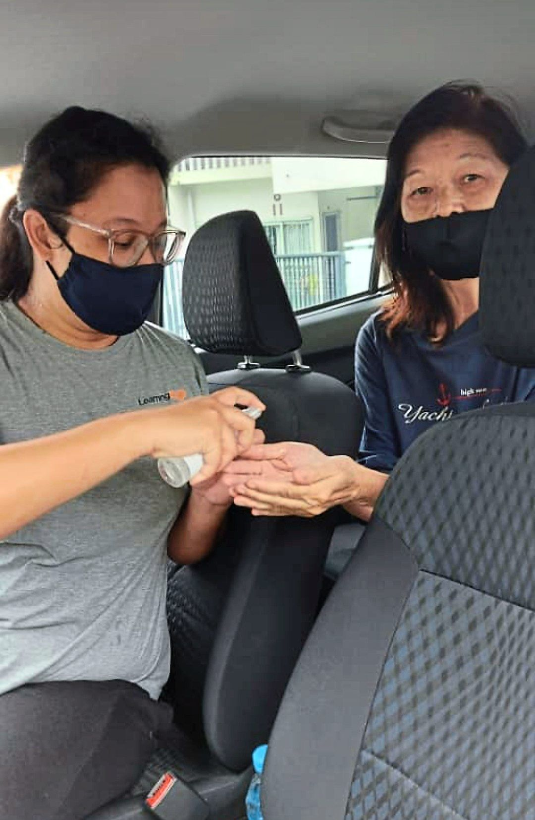 With a mask and hand sanitiser, Li (right) is better protected against Covid-19.
