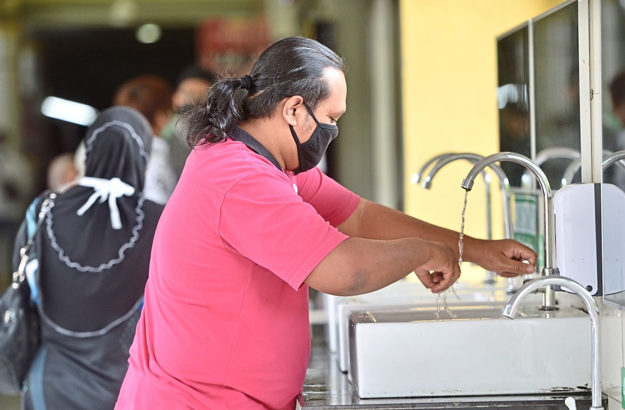 Hand washing is one of the most effective ways to curb the spread of the Covid-19 virus. Photo: The Star/Raja Faisal Hishan