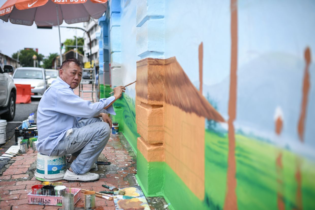 'I hope this mural can bring back memories and a touch of nostalgia besides educating the younger generation about the hardships of farmers who used to grow rice and earn a living,' says Chen. Photo: Bernama