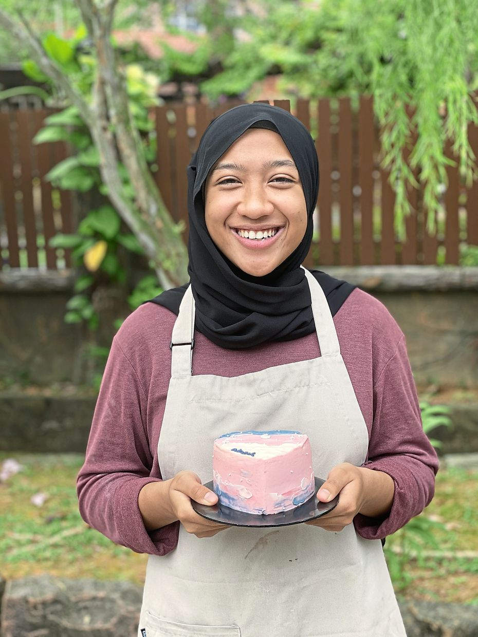 After losing a treasured internship, Nadhirah quickly pivoted and started selling custom cakes and desserts from home. — NURUL NADHIRAH ABDUL AZIS