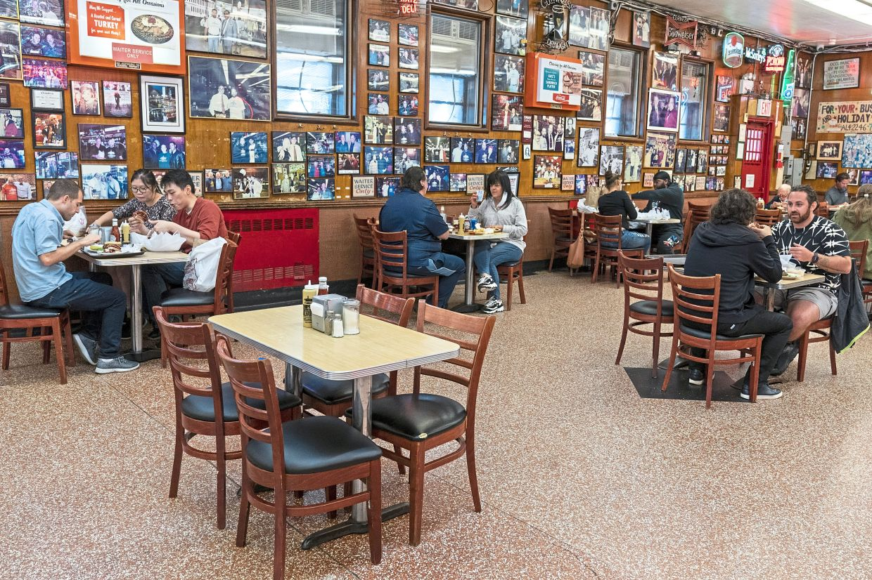 If opting to eat indoors, make sure tables are spaced far away from other diners and away from air-conditioning systems. — AP