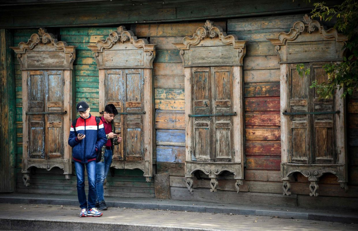 An example of the frontage of a traditional wooden house in the Siberian city of Tomsk. Photo: AFP