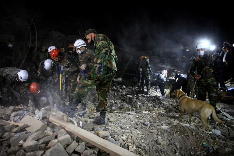 Search and rescue teams work on the blast site hit by a rocket during the fighting over the breakaway region of Nagorno-Karabakh in the city of Ganja Azerbaijan October 17 2020. REUTERSUmit Bektas