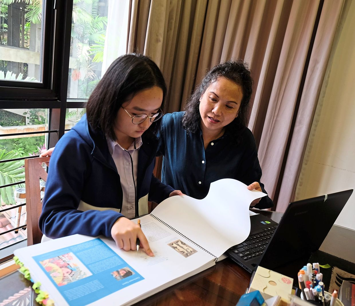 Architect Junn Ng (right) and her daughter Ch'ng Symn researching material for their book 'The Legacy And Heritage Of Loke Chow Kit'.
