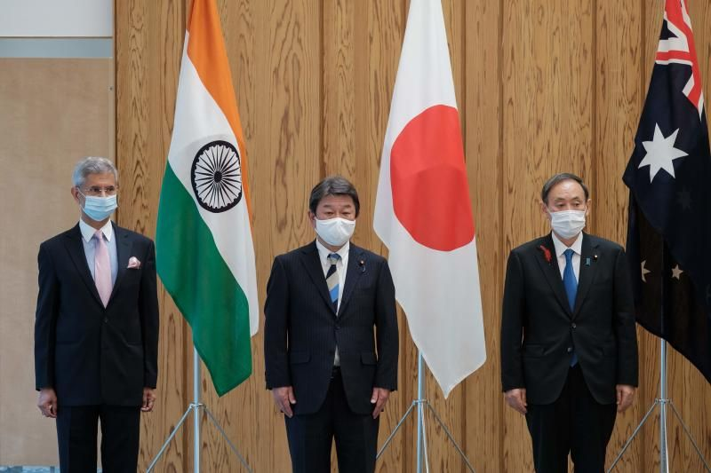 (From left) India's Foreign Minister Subrahmanyam Jaishankar, Japan's Foreign Minister Toshimitsu Motegi and Japan's Prime Minister Yoshihide Suga pose for photographs before a Quad Indo-Pacific meeting at the prime minister's office in Tokyo on Oct 6, 2020 in Tokyo.