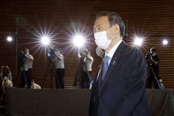 Japan's populist, pragmatic new PM Suga pushes Abe's vision