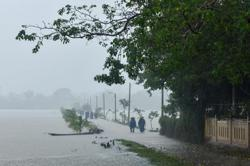 Landslide hits Vietnam army barracks, 22 soldiers missing; bad weather hampers search