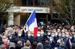 'Teaching yes, bleeding no': France pays tribute to beheaded teacher