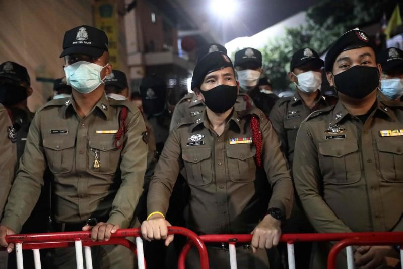 Police standing guard outside the Nonthaburi police station during an anti-government rally by pro-democracy protesters on the ouskirts of Bangkok on Monday (Oct 19). - AFP