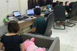 Teenager among 12 detained for operating online gambling centre