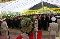 Vietnam honours fallen flood rescuers; 90 more dead and 34 missing due to floods, landslides